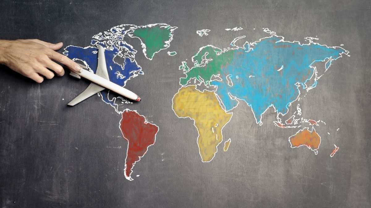 Internatioanal expansion blog image with world map and model airplane